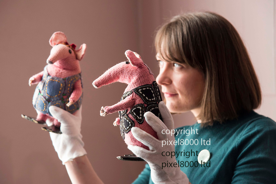 Pic shows:  Museum staff holds The Clangers<br /> <br /> <br /> Bagpuss and Clangers <br /> New exhibition at V&A Museum of Childhood, London<br /> <br /> Created by Oliver Postgate at Peter Firmin of Smallfilms<br /> <br /> <br /> <br /> <br /> Pic by Gavin Rodgers/Pixel 8000 Ltd