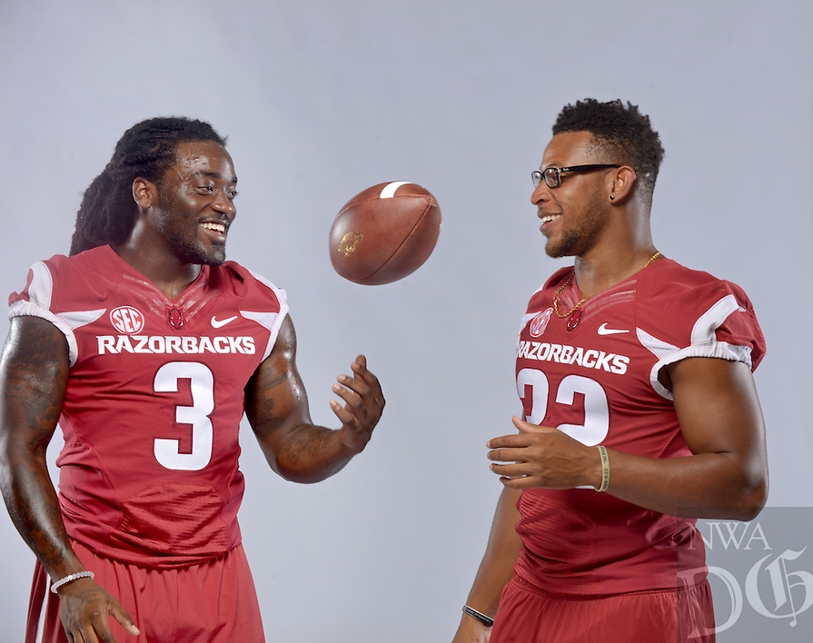 NWA Democrat-Gazette/BEN GOFF • @NWABENGOFF<br /> Alex Collins (left) and fellow running back Jonathan Williams pose for a photos on Sunday Aug. 9, 2015 during Arkansas football media day at the Fred W. Smith Football Center in Fayetteville.