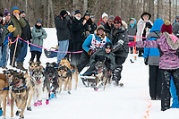 Matthew Failor and team run past spectators on the bike/ski trail near University Lake with an Iditarider in the basket and a handler during the Anchorage, Alaska ceremonial start on Saturday, March 7 during the 2020 Iditarod race. Photo © 2020 by Ed Bennett/Bennett Images LLC