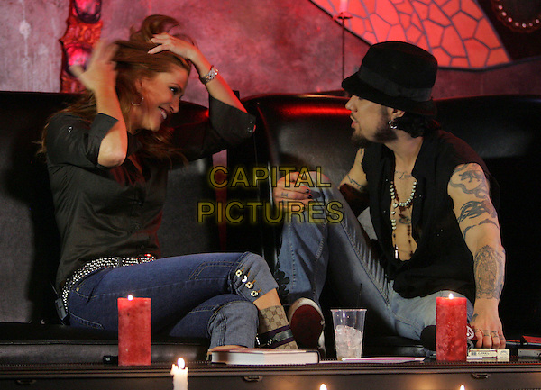 ANGIE EVERHART & DAVE NAVARRO.At Dave Navarro's Spread Entertainment weekly internet show,episode 3 on Maniatv.com held at The Dragonfly in Hollywood, California, USA..May 31st, 2007.full length brown shirt hands in hair gesture profile black hat tattoos.CAP/DVS.©Debbie VanStory/Capital Pictures