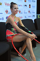 "Daria Dmitrieva of Russia smiles from ""kiss & cry"" after performing in hoop Event Finals at 2010 World Cup at Portimao, Portugal on March 14, 2010.  (Photo by Tom Theobald)."