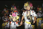 Dressed in festive attire, a father leads his son in the Nebura Festival in Aomori, Japan.  Huge illuminated paper-mache floats made of lumber, bamboo, wire and paper depicting men, animals and birds are pushed and pulled through the streets by groups of men, women and children during the Nebuta Festival in Aomori, Japan.  The festival dates back to the beginning of the eight century when the Ezo residents in northern Honshu rose in revolt. The Emperor sent General Sakanoue-no-Tamramaro, who, built Nebuta dummies of men and horses which were floated away at night. The Ezo thinking the Imperial troops had withdrawn, came back into the city only to be slaughtered by troops waiting in secret. Themes of the floats are picked from Kabuki stages, historical characters or fairy tales. (Jim Bryant Photo).....