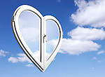 Conceptual stock photo-illustration of a White heart-shaped PVC window over blue cloudy summer sky background Creative window system design Home renovation Construction industry Interior design Ecology Environment concept