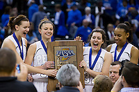 Penn players react after receiving the trophy following a 68-48 win against Columbus North in the IHSAA Class 4A Girls Basketball State Championship Game on Saturday, Feb. 27, 2016, at Bankers Life Fieldhouse in Indianapolis.