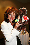 """OLTL's Hillary B. Smith """"Nora"""" holds a bear given to her by a fan at the  One Life To Live Fan Club Luncheon on August 16, 2008 at the New York Marriott Marquis, New York, New York.  (Photo by Sue Coflin/Max Photos)"""
