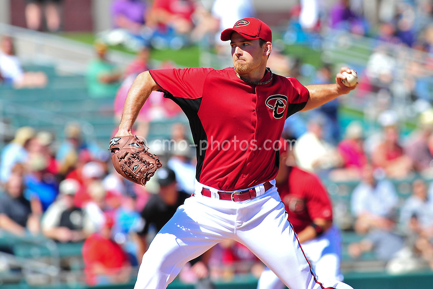 Mar 7, 2011; Tucson, AZ, USA; Arizona Diamondbacks pitcher Zach Duke (19) throws a pitch in the 1st inning of a charity exhibition game against the Chicago White Sox at the Kino Sports Complex.
