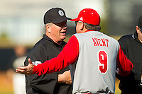 North Carolina State Wolfpack head coach Elliott Avent (9) argues a call with third base umpire Timothy O'Toole (left) during the game against the Wake Forest Demon Deacons at Wake Forest Baseball Park on March 16, 2013 in Winston-Salem, North Carolina.  The Demon Deacons defeated the Wolfpack 13-4.  (Brian Westerholt/Four Seam Images)