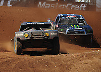 Apr 16, 2011; Surprise, AZ USA; LOORRS driver Kyle Leduc (99) leads Johnny Greaves (16) during round 3 at Speedworld Off Road Park. Mandatory Credit: Mark J. Rebilas-.
