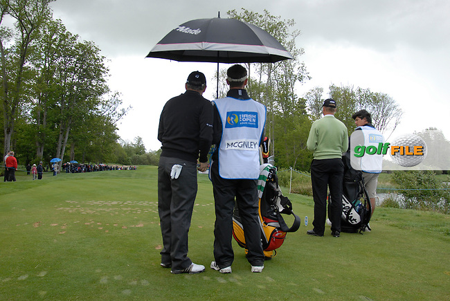 Paul McGinley and Martin Erlandsson wait for the rain to abate on the 4th tee during the third round of the Irish Open on 19th of May 2007 at the Adare Manor Hotel & Golf Resort, Co. Limerick, Ireland. (Photo by Eoin Clarke/NEWSFILE).