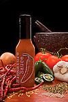 Still life ad for hot sauce.