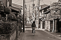 Bicycling on a street in Nara Japan January 2010