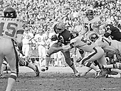 Washington Redskins running back Larry Brown (43) carries the ball against the New York Giants at RFK Stadium in Washington, DC on December 5, 1971. Involved in the pursuit are middle linebacker Jim Files (58), left defensive tackle Jim Kanicki (73), and right linebacker John Douglas (51). At left is Giant Pete Athas (45) and at right is Redskin offensive tackle Jim Snowden (74).  The Redskins won the game 23 - 7.<br /> Credit: Arnie Sachs / CNP