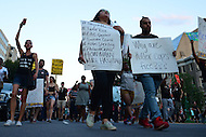 Washington, DC - July 9, 2016: Protestors from the Black Lives Matter movement, supporters and other organizations engage in a peaceful protest against police brutality as they march though the streets of the District of Columbia, July 9, 2016. This protest comes amid many around the U.S. in the days following the police-involved shootings of Alton Sterling in Louisiana and Philando Castile in Minnesota.  (Photo by Don Baxter/Media Images International)