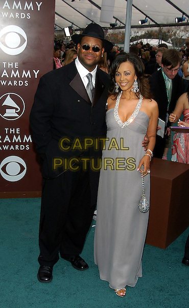 JIMMY JAM.47th Annual Grammy Awards - Arrivals. Los Angeles, California .February 13th, 2005.Photo Credit: Jacqui Wong/AdMedia.full length black suit grey gray dress halterneck cleavage jewel encrusted bag purse.www.capitalpictures.com.sales@capitalpictures.com.© Capital Pictures.