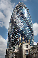 The Swiss Re building, known as the Gherkin, 1997 -  2004, Foster and Partners, Arup Engineering, London, UK. In the foreground St Andrew Undershaft church can be seen. Picture by Manuel Cohen