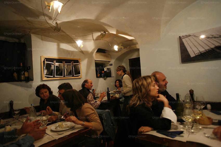 The Berlocca restaurant, Via del Macelli de Soziglia, 45r. Anna Donato with  clients  at her  restaurant.The Best Restaurants in Genoa