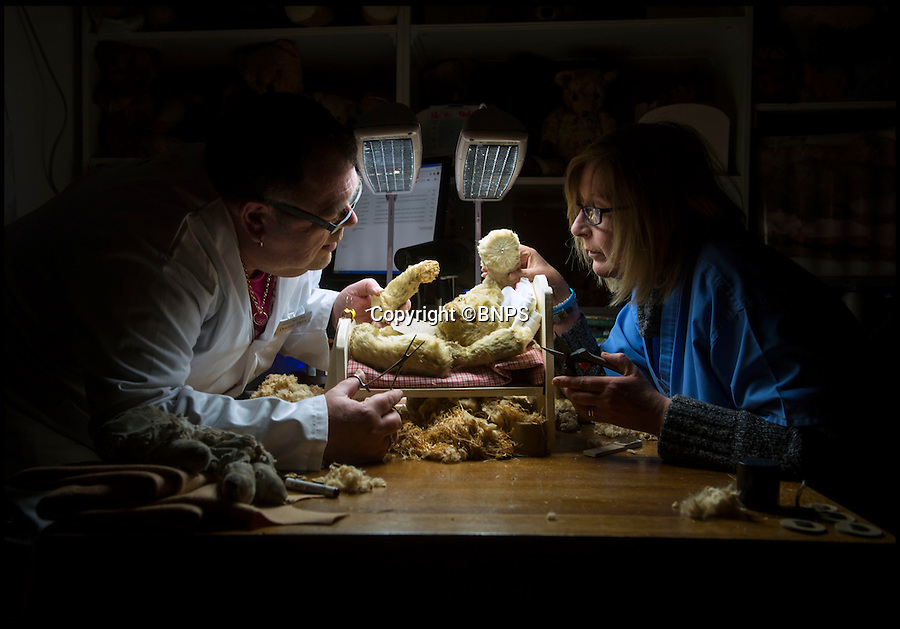 BNPS.co.uk (01202 558833)<br /> Pic: PhilYeomans/BNPS<br /> <br /> Husband and wife team 'Dr' Dave and 'nurse' Lesley at work on a very poorly patient.<br /> <br /> Broken bears and deteriorating dolls from all over the world are being brought back to life by a UK team of dedicated doctors and nurses at one of the last remaining toy hospitals.<br /> <br /> The team at Alice's Bear Shop, a teddy bear and doll hospital in Lyme Regis, Dorset, perform all kinds of 'surgery' from simple restringing and re-stuffing to head re-attachments and complete skin grafts.<br /> <br /> Rikey Austin, 49, opened the hospital in January 2000 but also ran a shop and only repaired one or two toys a month.<br /> <br /> Now she has a four-month waiting list for patients and has had to close the shop to focus on the hospital side of the business.