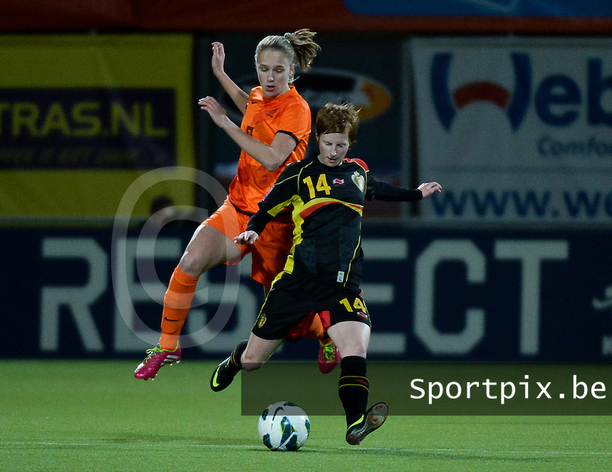 20140212 - ZWOLLE , THE NETHERLANDS : Belgian Lien Mermans (r) pictured with Dutch Vivianne Miedema (l) during the female soccer match between The Netherlands and Belgium , on the fifth matchday in group 5 of the UEFA qualifying round to the FIFA Women World Cup in Canada 2015 at Het Ijseldelta Stadion , Zwolle . Wednesday 12th February 2014 . PHOTO DAVID CATRY