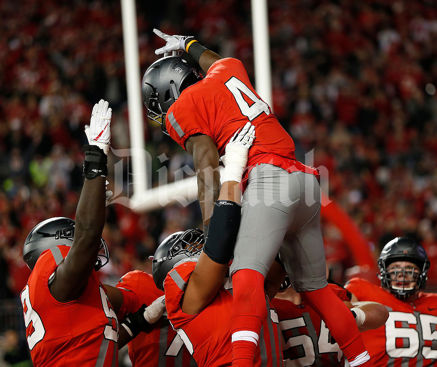 Ohio State Buckeyes running back Curtis Samuel (4) celebrates his touchdown during first quarter of the NCAA football game between the Ohio State Buckeyes and the Nebraska Cornhuskers at Ohio Stadium in Columbus on Saturday, November 5, 2016. (Columbus Dispatch photo by Jonathan Quilter)