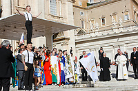 A young circus artists performs at the end of the weekly general audience held by Pope Francis, seen at right, in St. Peter's Square at the Vatican City, October 16, 2019. UPDATE IMAGES PRESS/Riccardo De Luca<br /> <br /> STRICTLY ONLY FOR EDITORIAL USE