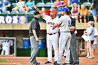 First base umpire Lance Seilhamer,  Greeneville Astros manager Danny Ortega (53), Kingsport Mets manager Luis Rivera (9) and home plate umpire Brandon Blome go over ground rules before a game between the Kingsport Mets and the Greeneville Astros at Pioneer Park on July 1, 2017 in Greeneville, Tennessee. The Astros defeated the Mets 6-2. (Tony Farlow/Four Seam Images)