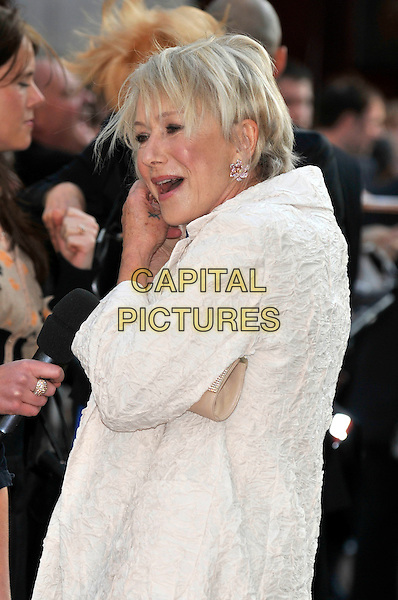 "DAME HELEN MIRREN.Attending ""State of Play"" World Film Premiere at Empire cinema, Leicester Square, London, England, UK, .21st April 2009..half length white cream coat  microphone interview funny hand .CAP/PL.©Phil Loftus/Capital Pictures"