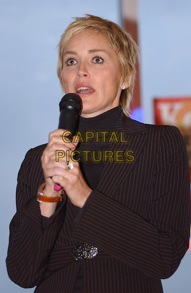 SHARON STONE .Speaks at a John Kerry/John Edwards reception held at the home of Peter Karlovich and Steven Herforth in Mt. Washington. .October 14th, 2004.headshot, portrait, brown pinstripe suit jacket, microphone.www.capitalpictures.com.sales@capitalpictures.com.© Capital Pictures.