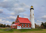 A very cute Lighthouse, The Tawas Point Lighthouse on a stormy autumn evening in the Tawas Point State Park, with Lake Huron to one side and Tawas Bay on the other, Lower Peninsula, Michigan; USA