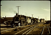 D&amp;RGW #483 K-36 with flanger and a second engine with flanger &amp; 2 cabooses.  Dual track in forground.<br /> D&amp;RGW  Alamosa, CO