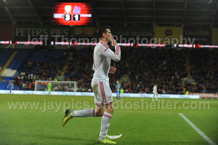 Celebration by Gareth Bale of Wales after scoring his sides 3rd goal. Cardiff City Stadium, Cardiff, Wales, Wednesday 5th March 2014. The Football Association of Wales - Vauxhall International Friendly - Wales v Iceland. Pictures by Jeff Thomas Photography - www.jaypics.photoshelter.com - Contact: thomastwotimes@live.co.uk - 07837 386244