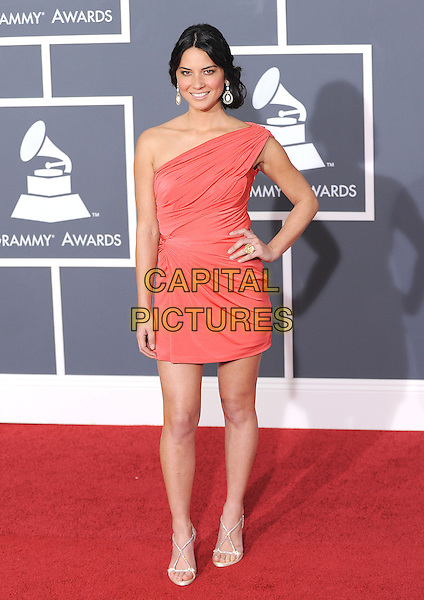 OLIVIA MUNN.Arrivals at the 52nd Annual GRAMMY Awards held at The Staples Center in Los Angeles, California, USA..January 31st, 2010.grammys full length pink coral one shoulder dress hand on hip ruched .CAP/RKE/DVS.©DVS/RockinExposures/Capital Pictures