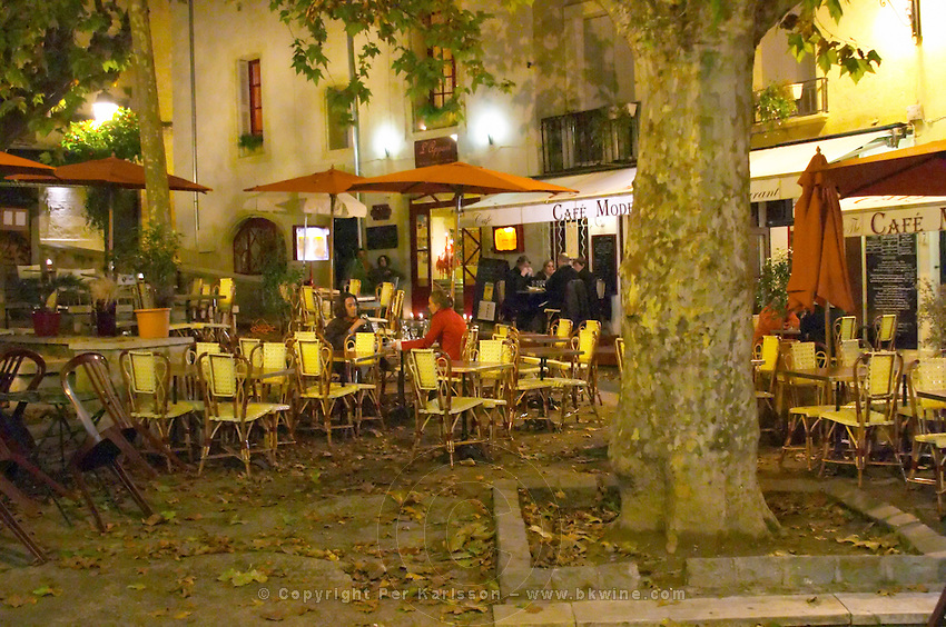 A city square with cafes and restaurants at night. Montpellier. Languedoc. France. Europe.