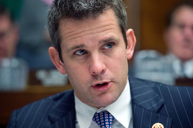 UNITED STATES - OCTOBER 30: Rep. Adam Kinzinger, R-Ill., questions HHS Secretary Kathleen Sebelius during her testimony before a House Energy and Commerce Committee hearing in Rayburn Building on the failures of Affordable Care Act's enrollment website. (Photo By Tom Williams/CQ Roll Call)