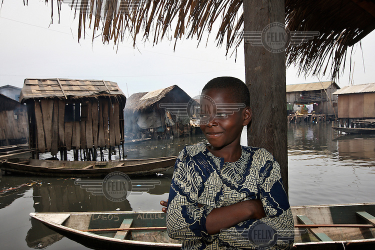 A young boy stands outside his house in Makoko, a slum district on Lagos Lagoon.