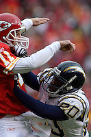 San Diego Chargers safety Marion McCree hits Chiefs quarterback Damon Huard as he releases the ball during the first half at Arrowhead Stadium  in Kansas City, MO on October 22, 2006. The Chiefs won 30-27.