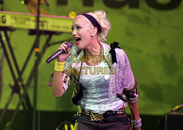 NO DOUBT -  GWEN STEFANI.Live at The Music for Relief Tsunami Benefit Concert held at The Pond of Anaheim in Anaheim, California   .February 18th, 2005.half length stage gig singing   .www.capitalpictures.com.sales@capitalpictures.com.Supplied by Capital PIctures
