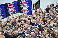 A Bath supporter in the crowd waves a giant Bath Rugby flag. Aviva Premiership match, between Bath Rugby and Leicester Tigers on September 14, 2013 at the Recreation Ground in Bath, England. Photo by: Patrick Khachfe / Onside Images