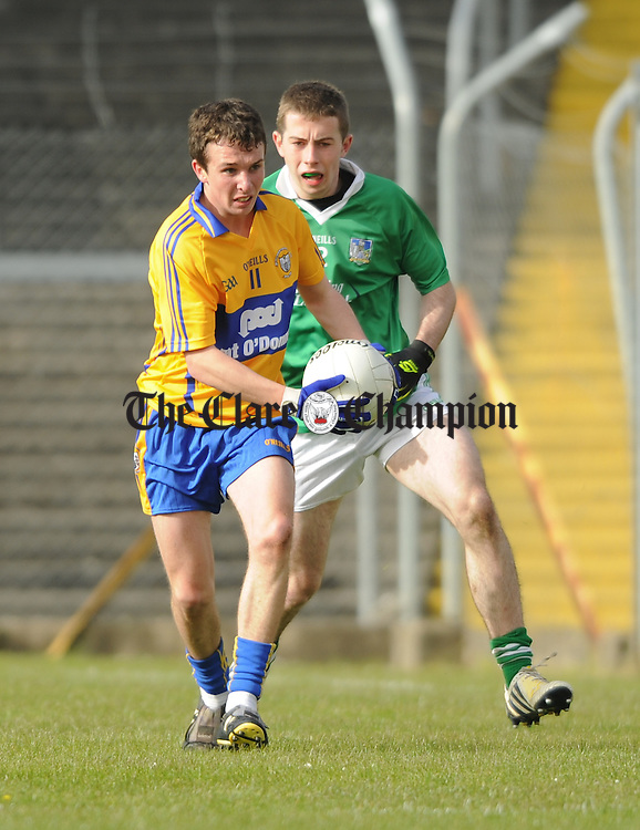 Paddy O Malley of Clare in action against Sam Mullins of Limerick during their Munster minor championship semi-final at Cusack park. Photograph by John  Kelly.