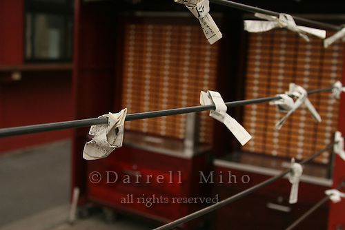 Mar 6, 2006; Tokyo, JPN; Asakusa.Mikuji (written fortunes) are tied to a wire for the gods blessing at the Senso-ji temple...Photo credit:  Darrell Miho