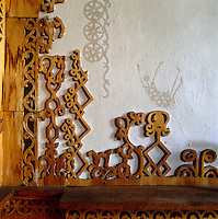 Detail of fretwork and stencil on wall