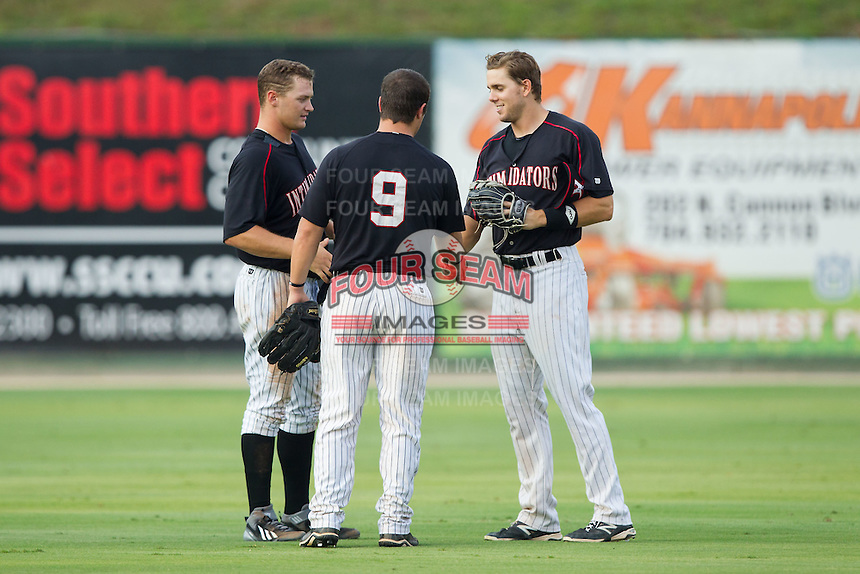 (L-R) Adam Engel (23), Nolan Early (9) and Jacob Morris (24) celebrate their victory over the Lakewood BlueClaws at CMC-NorthEast Stadium on July 20, 2014 in Kannapolis, North Carolina.  The Intimidators defeated the BlueClaws 7-6. (Brian Westerholt/Four Seam Images)