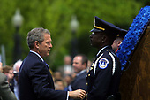United States President George W. Bush lays a wreath at the 20th Annual Peace Officers Memorial Service, which pays tribute to fallen law enforcement officers 15 May 2001 on the lawn of the US Capitol. More than 150 US police officers were killed in the line of duty last year.  <br /> Credit: Jamal A. Wilson / Pool via CNP