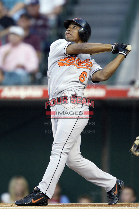 Melvin Mora of the Baltimore Orioles bats during a 2002 MLB season game against the Los Angeles Angels at Angel Stadium, in Los Angeles, California. (Larry Goren/Four Seam Images)