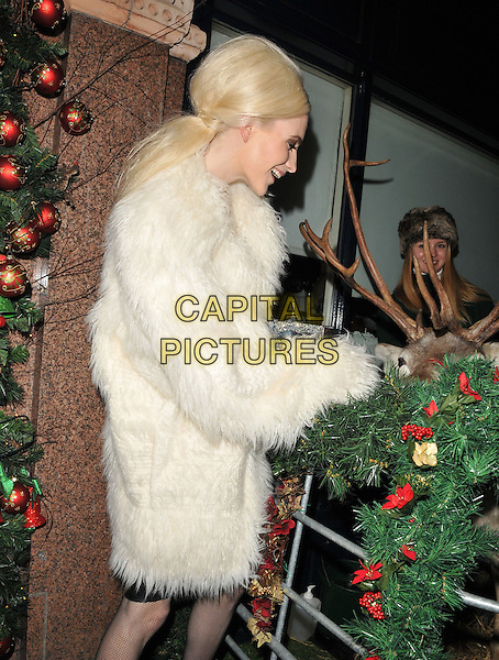 Poppy Delevingne attends the LOVE magazine Christmas party, George Club, Mount Street, London, UK, on Friday 18 December 2015.<br /> CAP/CAN<br /> &copy;Can Nguyen/Capital Pictures