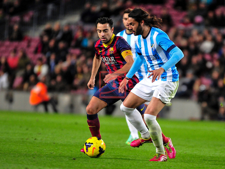 League BBVA 2013/2014 - Game: 21.<br /> FC Barcelona vs Malaga CF: 3-0.<br /> Xavi Hernandez vs Sergio Sanchez.