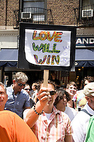 Crowds watch the 2011 NYC Pride March on 26 June 2011 in New York, New York, held two days after the New York State Senate voted 33-29 to legalize gay marriage.