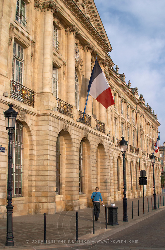 Place de la Bourse. French flag on the facade. Bordeaux city, Aquitaine, Gironde, France