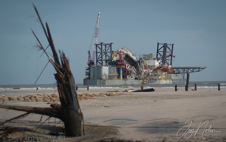 A damaged oil rig gets washed ashore on Dauphin Island after Hurricane Katrina makes landfall in New Orleans.