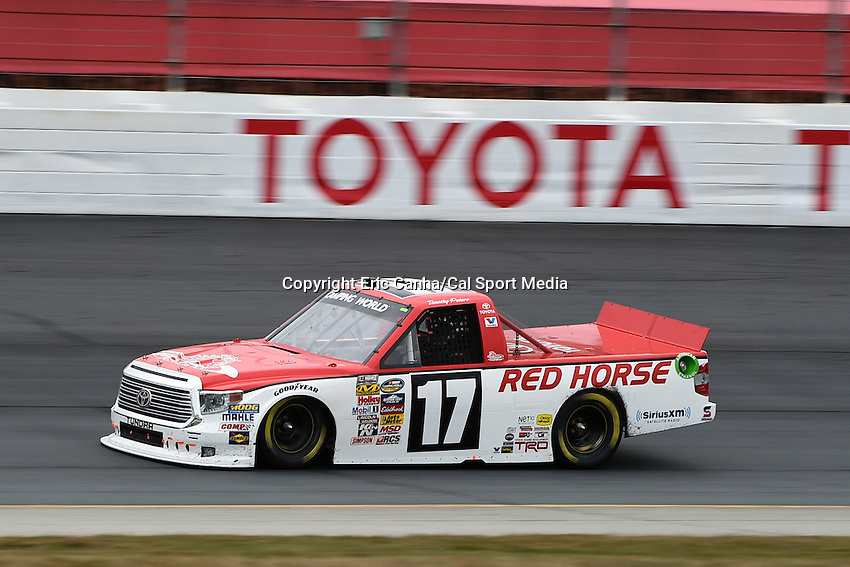 September 19, 2014 - Loudon, New Hampshire, U.S. -  Timothy Peters, NASCAR Camping World Truck Series driver of the #17 Red Horse Racing Toyota truck races in  the NASCAR Camping World Truck Series UNOH 175 race held at the New Hampshire Motor Speedway in Loudon, New Hampshire.   Eric Canha/CSM