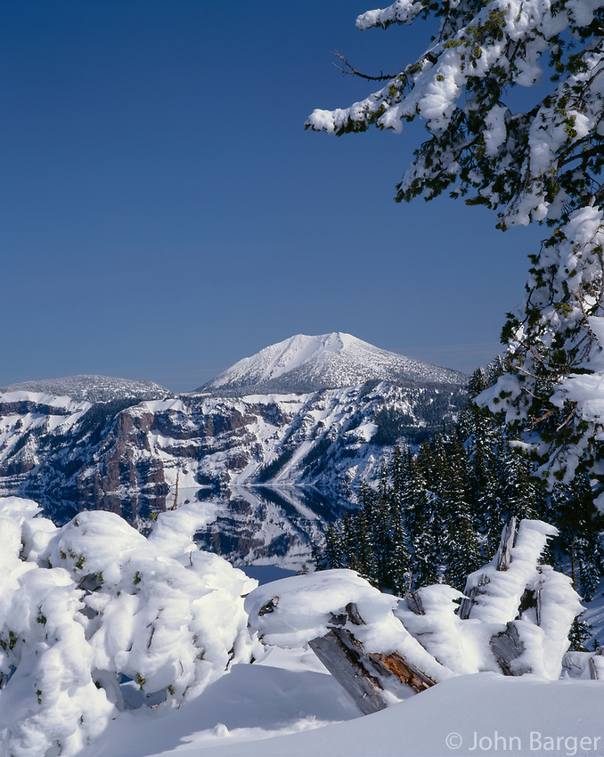 67ORCL_03 - USA, Oregon, Crater Lake National Park, Winter snow accumulates at Crater Lake and on distant Mount Scott.